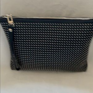 Black large wristlet/clutch with hand strap.